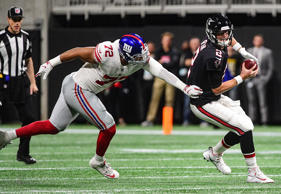 The Giants defensive end Kerry Wynn (72) works to sack Falcons quarterback Matt Ryan (2) on Oct. 22, in Atlanta.