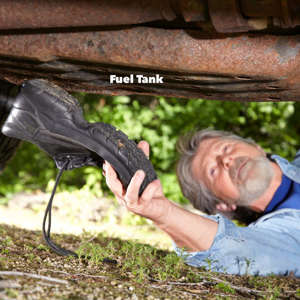 a man holding a bird: smack fuel tank with shoe car won't start
