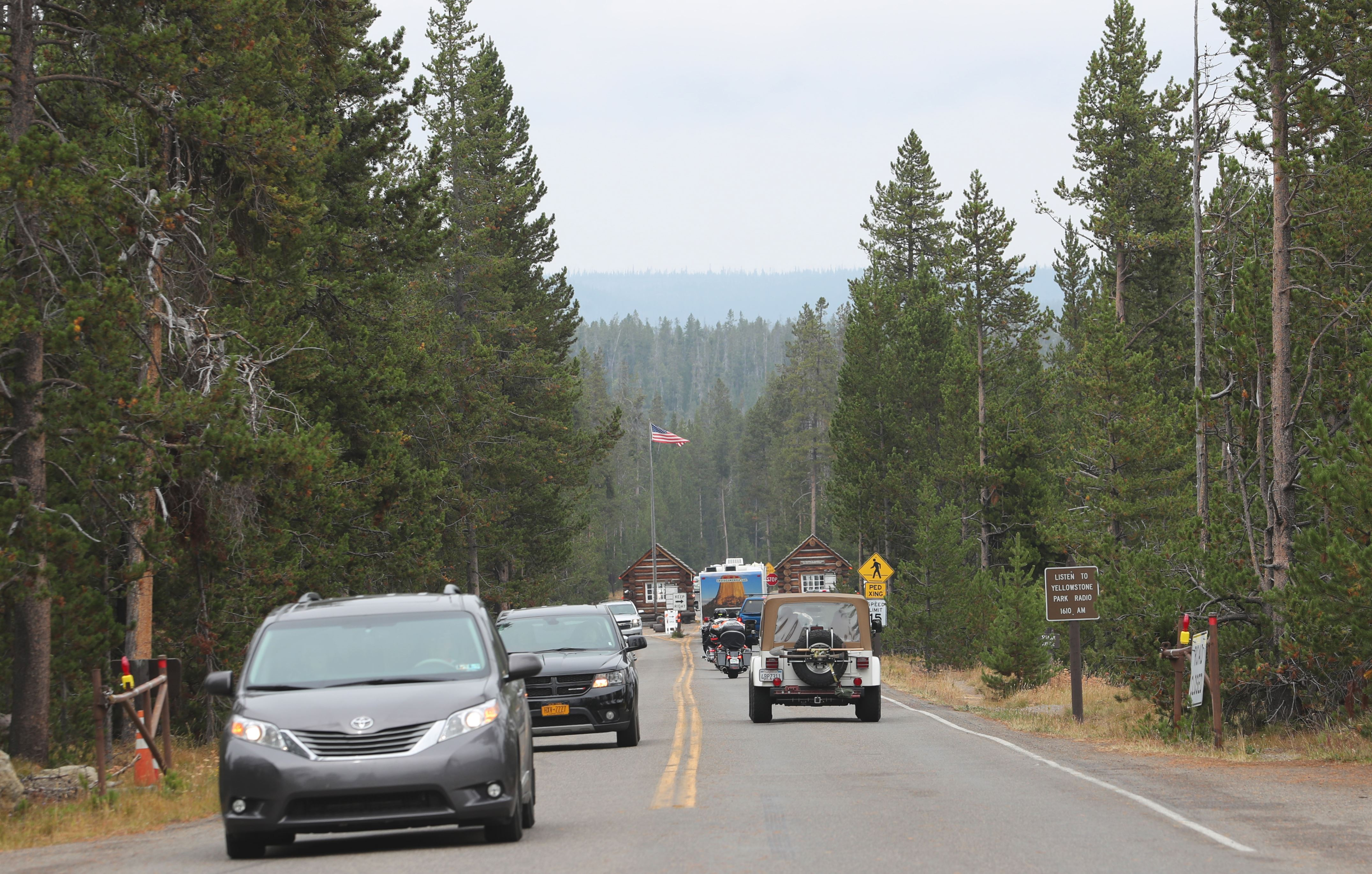 YELLOWSTONE, WY - AUGUST 22: Visitors come and go at the south entrance of Yellowstone National Park, Wyoming on August 22, 2018. Yellowstone is one of the most visited national parks in the United States. (Photo by George Frey/Getty Images)
