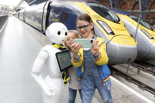 Slide 32 of 39: Pepper the robot meets Eurostar customers at St Pancras International station in London, England. Pepper will be available to entertain customers, offering information about their journey before departure on Oct. 23.