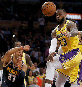 Denver Nuggets guard Jamal Murray, left, passes the ball away from Los Angeles Lakers forward LeBron James, right, during the second half of an NBA basketball game in Los Angeles, Thursday, Oct. 25, 2018. Lakers won 121-114. (AP Photo/Alex Gallardo)