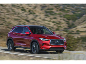 a red car parked on the side of a road: 2019 Infiniti QX50