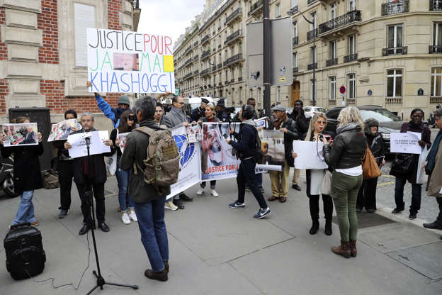 Slide 5 of 66: Protestors hold placards as they stage a protest outside the Saudi Arabian Embassy in Paris on Oct. 26, after the assasination of journalist Jamal Khashoggi in Turkey.