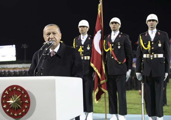 Slide 3 of 66: Turkey's President Recep Tayyip Erdogan talks during a gendarmerie and coast guard academy's graduation ceremony in Ankara, Turkey, Friday, Oct. 26, 2018. The Saudi officials who killed journalist Jamal Khashoggi in their Istanbul consulate must reveal the location of his body, Turkey's president said Friday in remarks that were sharply critical of the kingdom's handling of the case. Erdogan also said Saudi Arabia's chief prosecutor will arrive in Turkey on Sunday. (Presidential Press Service via AP, Pool)