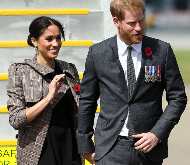 Harry and Meghan receive traditional Maori greeting as they land in