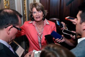 Sen. Lisa Murkowski, R-Alaska, talks with reporters after the confirmation vote of Supreme Court nominee Brett Kavanaugh, on Capitol Hill, Saturday, Oct. 6, 2018 in Washington.