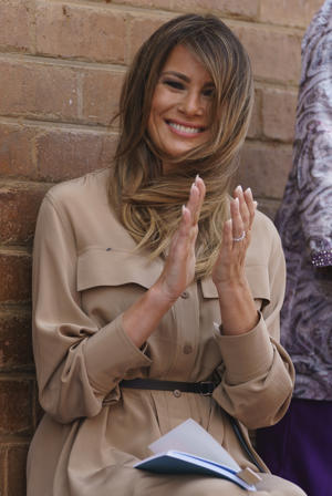 First lady Melania Trump applauds a class as she visits Chipala Primary School, in Lilongwe, Malawi, Thursday, Oct. 4, 2018. Melania Trump is visiting Africa on her first big solo international trip, aiming to make child well-being the focus of a five-day, four-country tour. (AP Photo/Carolyn Kaster)