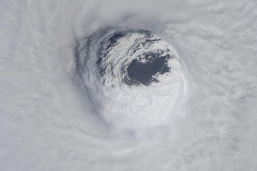 Slide 2 of 47: This photo made available by NASA shows they eye of Hurricane Michael, as seen from the International Space Station on Wednesday, Oct. 10, 2018. (NASA via AP)
