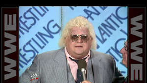 "a man wearing a suit and tie: Dusty Rhodes has a message for Ric Flair about ""hard times."""