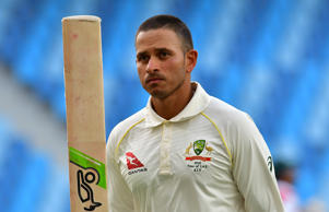 Australian cricketer Usman Khawaja leaves the pitch after being dismissed by Pakistan batsman Yasir Shah for 141 runs.