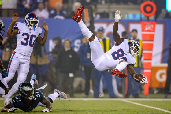 Slide 1 of 19: Oct 11, 2018; East Rutherford, NJ, USA; New York Giants wide receiver Jawill Davis (80) is upended by Philadelphia Eagles cornerback Jalen Mills (31) as he runs out the opening kickoff during the first quarter at MetLife Stadium.