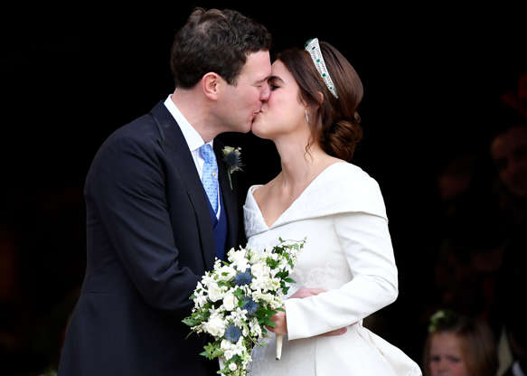 Slide 1 of 73: Britain's Princess Eugenie and Jack Brooksbank kiss as they leave after their wedding at St George's Chapel in Windsor Castle, Windsor, Britain October 12, 2018. REUTERS/Toby Melville