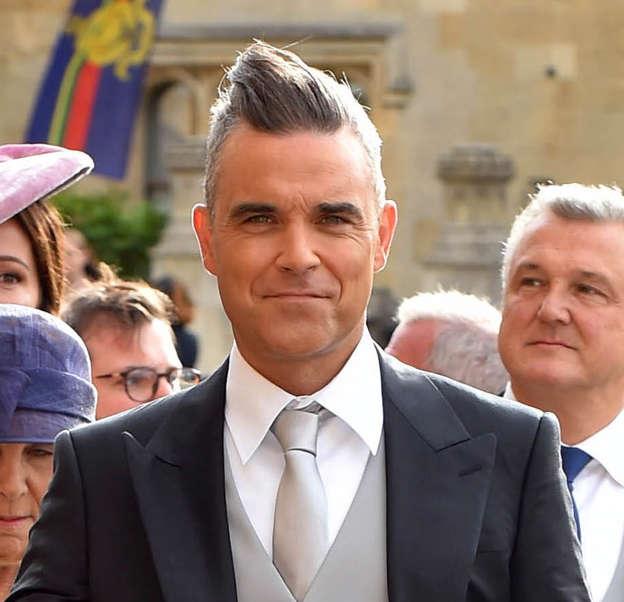 Royal Wedding Fans Fuming As Robbie Williams Chews Gum In St