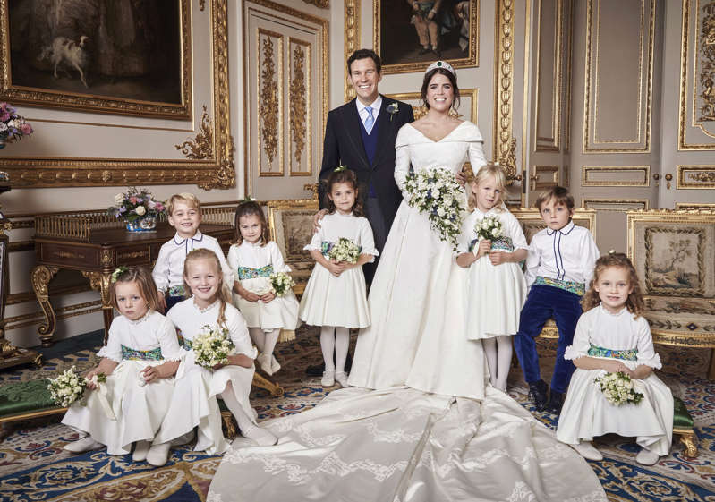 This official wedding photograph released by the Royal Communications of Princess Eugenie and Jack Brooksbank in the White Drawing Room, Windsor Castle with (left to right) Back row: His Royal Highness Prince George of Cambridge; Her Royal Highness Princess Charlotte of Cambridge; Miss Theodora Williams; Miss Isla Phillips; Master Louis De Givenchy Front row: Miss Mia Tindall; Miss Savannah Phillips; Miss Maud Windsor.