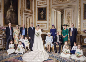 In this photo released on Saturday, Oct. 13 2018 by Buckingham Palace, Britain's Princess Eugenie of York and Jack Brooksbank are photographed in the White Drawing Room, Windsor Castle with from left, back row, Thomas Brooksbank, Nicola Brooksbank, George Brooksbank, Princess Beatrice, Sarah, Duchess of York, Prince Andrew, middle row, Prince George, Princess Charlotte, Queen Elizabeth II, Prince Philip, Maud Windsor, Louis De Givenchy, front row, Theodora Williams, Mia Tindall, Isla Phillips and Savannah Phillips, following their Wedding, at St George's Chapel, Windsor Castle on Friday, Oct. 12, 2018. (Alex Bramall/Buckingham Palace via AP)