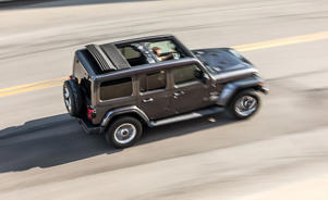 a car parked on the side of a road: The Jeep Wrangler Uses a Mild-Hybrid Four-Cylinder Approach to Improve Fuel