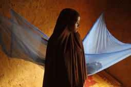 In this Wednesday, July 18, 2012, file photo, Zali Idy, 12, poses in her bedroom in the remote village of Hawkantaki, Niger. Zali was married in 2011. Child marriage affects nearly 15 million girls around the world, and West and Central Africa has six of the 10 countries with the highest rate.