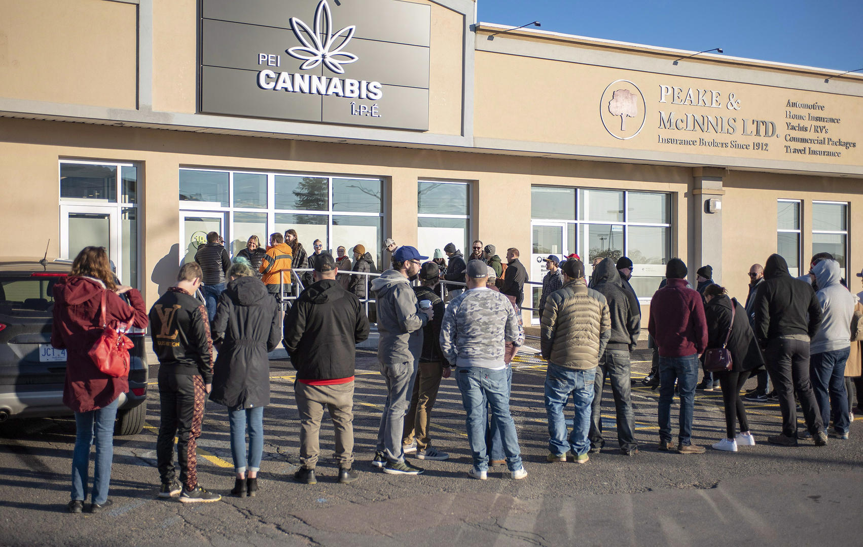 Slide 4 of 31: Customers line up at the retail cannabis store in Charlottetown, P.E.I., Wednesday October 17, 2018.