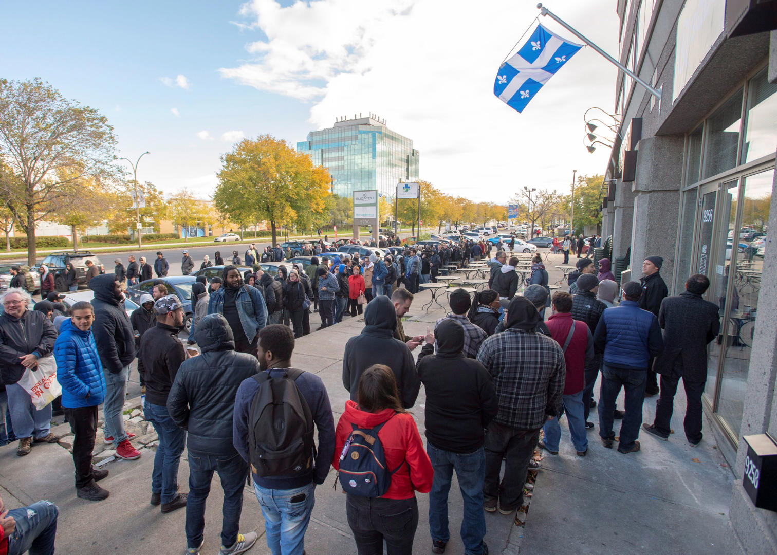 Slide 19 of 31: Hundreds of people line up at a government cannabis store Wednesday, October 17, 2018 in Montreal as the legal sale of cannabis begins in Canada.