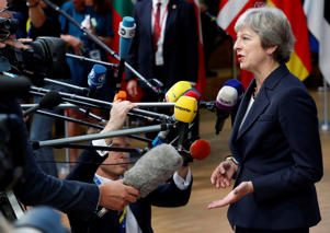 Prime Minister Theresa May speaks to the media at the European Union leaders summit in Brussels