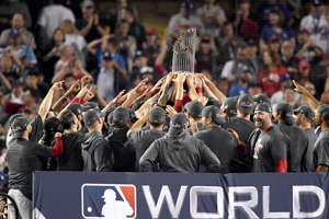 The Boston Red Sox celebrate with the World Series trophy after their 5-1 win over the Los Angeles Dodgers in Game Five to win the 2018 World Series at Dodger Stadium on October 28, 2018 in Los Angeles, California.