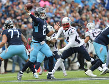 NASHVILLE, TN - NOVEMBER 11:  Tennessee Titans Marcus Mariota completes a pass to Darius Jennings against the New England Patriots during second quarter action at Nissan Field in Nashville on Nov. 11, 2018. (Photo by Matthew J. Lee/The Boston Globe via Getty Images)