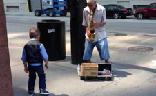 6-year-old performs spontaneous dance routine with street performer