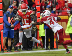 CAPTION: Kansas City Chiefs wide receiver Tyreek Hill picks up a first down past Arizona Cardinals free safety Antoine Bethea in the first quarter on Sunday, Nov. 11, 2018 at Arrowhead Stadium in Kansas City, Mo.