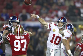 New York Giants quarterback Eli Manning (10) passes against the San Francisco 49ers during the first half of an NFL football game in Santa Clara, Calif., Monday, Nov. 12, 2018.