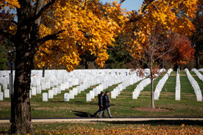 ARLINGTON, VA - NOVEMBER 11: People walk by theadstones at Arlington National Cemetery, on November 11, 2018 in Arlington, Virginia. (Photo by Al Drago/Getty Images)