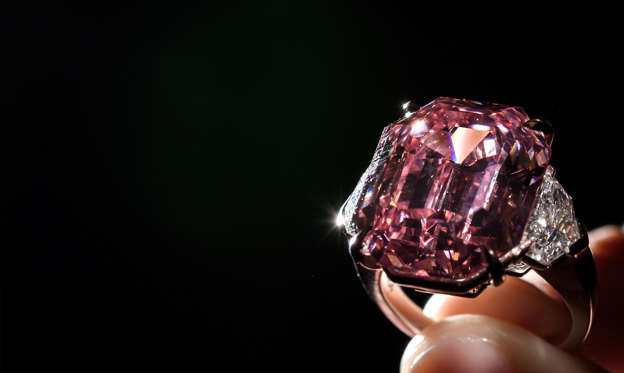 Slide 2 of 17: The Pink Legacy, a 18.96 carat fancy vivid pink diamond once owned by Oppenheimer family is displayed on November 8, 2018 during a press preview ahead of sales by Christie's auction house in Geneva. - The auction will take place in Geneva on November 13, 2018. (Photo by Fabrice COFFRINI / AFP)        (Photo credit should read FABRICE COFFRINI/AFP/Getty Images)
