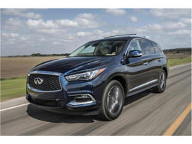 a car parked on the side of a road: 2018 Infiniti QX60