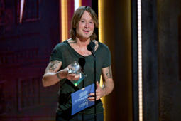 NASHVILLE, TN - NOVEMBER 14:  (FOR EDITORIAL USE ONLY) Keith Urban accepts the Entertainer of the Year Award onstage during the 52nd annual CMA Awards at the Bridgestone Arena on November 14, 2018 in Nashville, Tennessee.  (Photo by Erika Goldring/WireImage,)