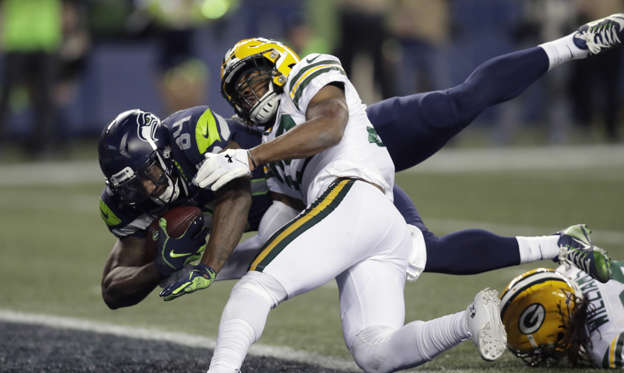 Slide 1 of 75: Seattle Seahawks tight end Ed Dickson, left, dives past Green Bay Packers defensive back Ibraheim Campbell, center, to score a touchdown after a reception during the second half of an NFL football game, Thursday, Nov. 15, 2018, in Seattle. (AP Photo/Stephen Brashear)