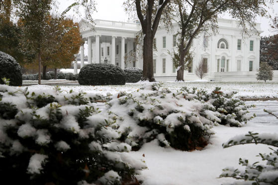 Slide 1 af 22: WASHINGTON, DC - NOVEMBER 15: Snow and sleet from Winter Storm Avery covers the ground at the White House November 15, 2018 in Washington, DC. After moving through the Midwest, the storm is dropping a wintry mix of snow, sleet and freezing rain, forcing schools to close or delay opening in the Washington, DC, area. (Photo by Chip Somodevilla/Getty Images)