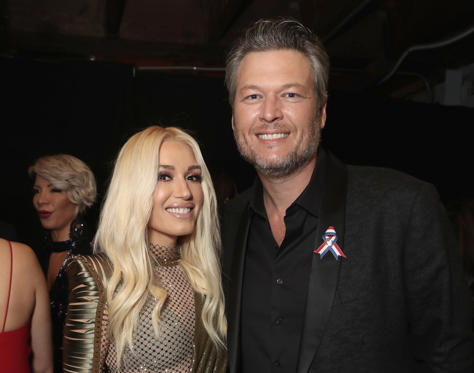 Slide 1 of 5: Gwen Stefani and Blake Shelton backstage during the 2018 E! People's Choice Awards held at the Barker Hangar on November 11, 2018.