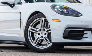 a car parked on the side of a road: 2018 Porsche Panamera 4/4S Sport Turismo