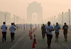 Participants run during a half marathon organised by Indian National Security Guard (NSG) on a smoggy morning in New Delhi, India, November 18, 2018. REUTERS/Altaf Hussain