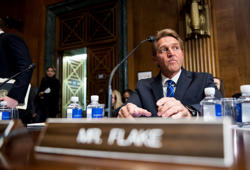 Sen. Jeff Flake, R-Ariz., takes his seat before the start of the Senate Judiciary Committee markup hearing in the Dirksen Senate Office Building on Thursday, Nov. 15, 2018.