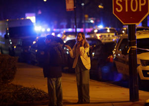 CHICAGO, IL - NOVEMBER 19:  Mercy Hospital workers stand outside the hospital after a gunman shot multiple people on November 19, 2018 in Chicago, Illinois. Five people were shot including a police officer and the gunman. (Photo by Joshua Lott/Getty Images)