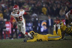Kansas City Chiefs quarterback Patrick Mahomes (15) tries for extra yardage as he is tripped up by Los Angeles Rams defensive tackle Ethan Westbrooks, right, during the second half of an NFL football game, Monday, Nov. 19, 2018, in Los Angeles. (AP Photo/Kelvin Kuo)