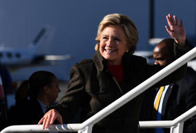 US Democratic presidential nominee Hillary Clinton waves as she boards her campaign plane at the Westchester County Airport in White Plains, New York, on October 31, 2016.  Clinton's campaign was jolted when FBI boss James Comey announced October 28 that his agents are reviewing a newly discovered trove of emails, resurrecting an issue Clinton had hoped was behind her. / AFP / Jewel SAMAD        (Photo credit should read JEWEL SAMAD/AFP/Getty Images)