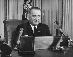 American President Lyndon Baines Johnson addresses the nation on his first thanksgiving day television programme, broadcast from the executive offices of the White House.