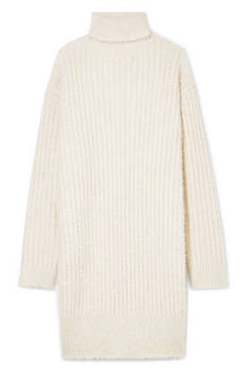 f482dfc09c634c Slide 1 of 10: SHOP NOW Snuggle up in Givenchy's ice white oversized ribbed  knit