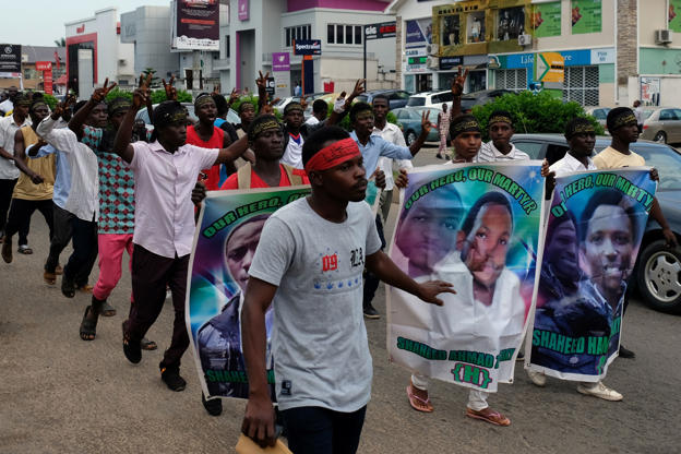 Slide 4 of 31: Members of the Islamic Movement of Nigeria gesture during a march to demand the release of their Nigerian Shi'ite leader Ibrahim Zakzaky, along a street in Abuja, Nigeria October 31, 2018. REUTERS/Paul Carsten