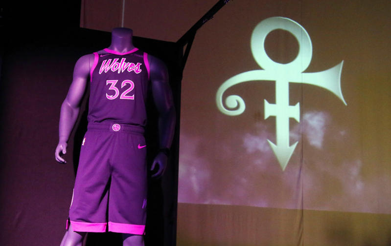 CAPTION: The new City Edition Minnesota Timberwolves uniform, honoring the legacy of the late rock star Prince, is unveiled Thursday, Nov. 1, 2018, in Chanhassen, Minn.