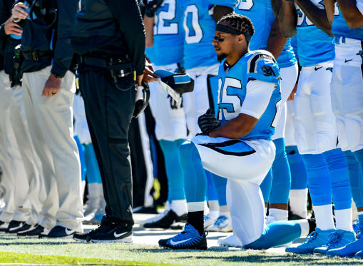 Slide 1 of 43: CHARLOTTE, NC - OCTOBER 28:  Eric Reid #25 of the Carolina Panthers kneels during the anthem against the Baltimore Ravens at Bank of America Stadium on October 28, 2018 in Charlotte, North Carolina.