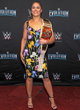Slide 1 of 75: Photo by MediaPunch/REX/Shutterstock (9947242aa) Ronda Rousey is seen at WWE Evolution, on Oct. 28 in New York. Wearing Dolce & Gabbana