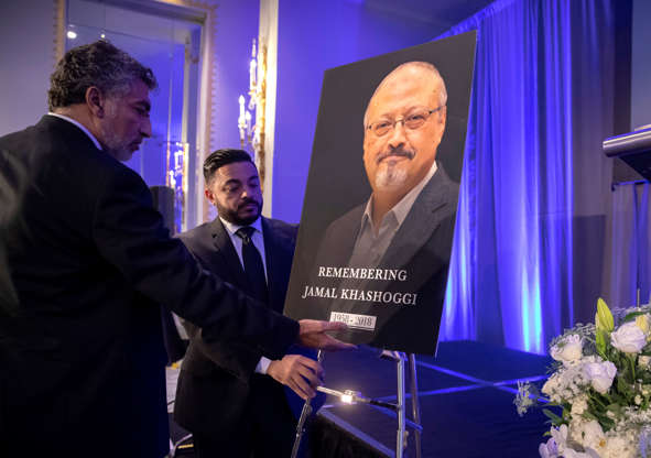 Slide 1 of 80: Mongi Dhaouadi, left, and Ahmed Bedier set up an image of slain Saudi journalist Jamal Khashoggi before an event to remember Khashoggi, a columnist for The Washington Post who was killed inside the Saudi Consulate in Istanbul on Oct. 2, in Washington, Friday, Nov. 2, 2018. (AP Photo/J. Scott Applewhite)