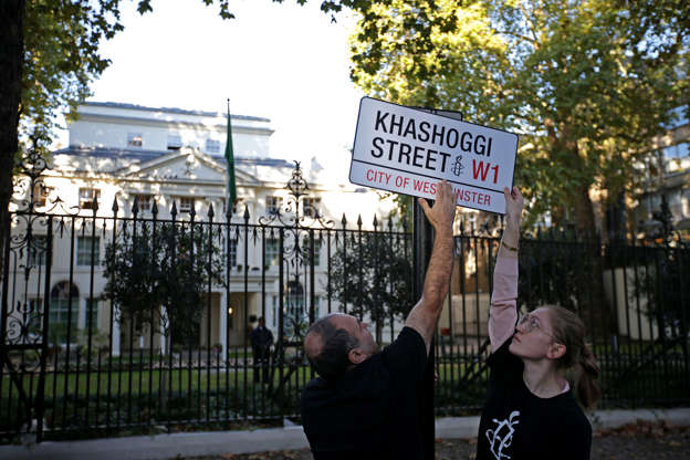 "Slide 3 of 80: A mock street sign reading ""Khashoggi Street"" is erected by Amnesty International activists on the street in front of the Embassy of Saudi Arabia in London on November 2, 2018 to mark one month since journalist Jamal Khashoggi was killed in Saudi Arabia's consulate in Istanbul. - The body of Jamal Khashoggi was ""dissolved"" after he was murdered and dismembered in the Saudi consulate in Istanbul a month ago, a Turkish official said November 2, as the journalist's fiancee criticised the US reaction as ""devoid of moral foundation"". The murder of the royal insider-turned-critic has provoked widespread outrage and fuelled an international debate about arms deliveries to Saudi Arabia. (Photo by Daniel LEAL-OLIVAS / AFP) (Photo credit should read DANIEL LEAL-OLIVAS/AFP/Getty Images)"